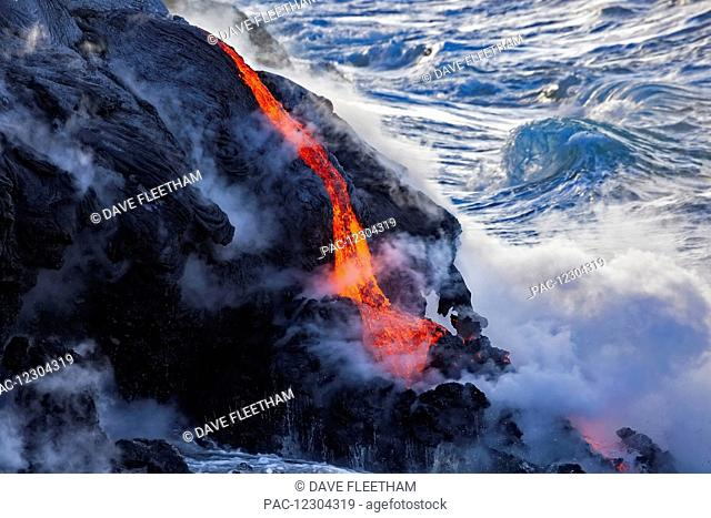 The Pahoehoe lava flowing from Kilauea has reached the Pacific ocean near Kalapana; Island of Hawaii, Hawaii, United States of America