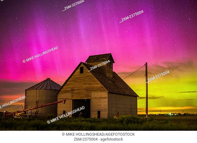Nothern lights dance above the Iowa landscape