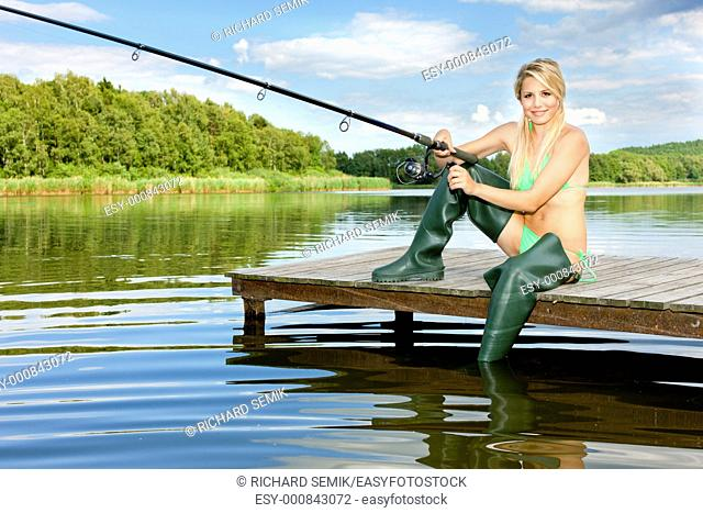 fishing woman sitting on pier