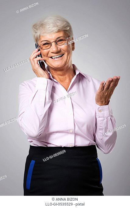 Senior woman talking by mobile phone. Debica, Poland