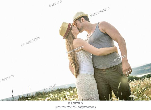 A Young couple in love outdoor at the sunset