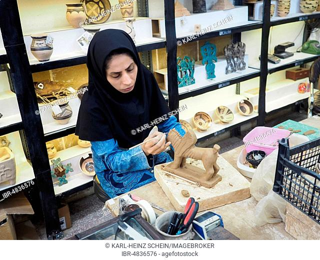 Potter working on clay figure, winged mythological being, Susa, Chuzestan Province, Iran