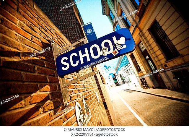 School street sign in the street, Antwerp Belgium