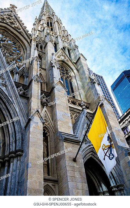 Ornate Entrance and Flag, Low Angle View, Saint Patrick's Cathedral, New York City, USA