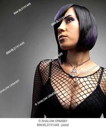 Sexy Hispanic woman in fishnet top