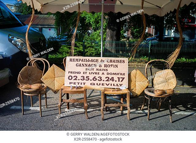 A typical chair repairers stall in the Sunday market of the small village of Darnetal near Rouen in France