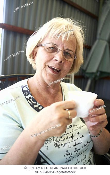 senior woman with cup at afternoon break