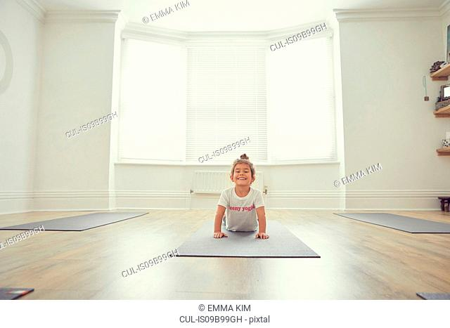 Young girl in yoga studio, in yoga position