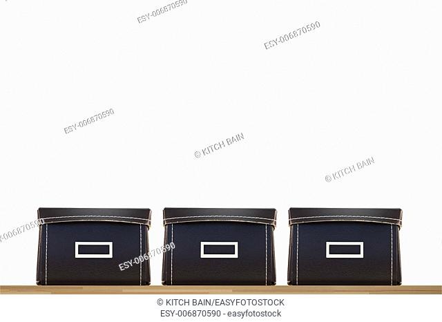 Storage boxes isolated on a wooden shelf