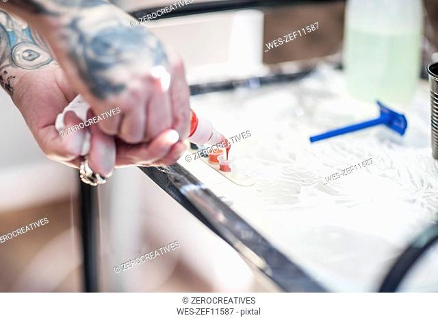 Tattoo artist in studio preparing