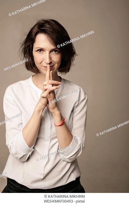 Portrait of woman wearing white blouse