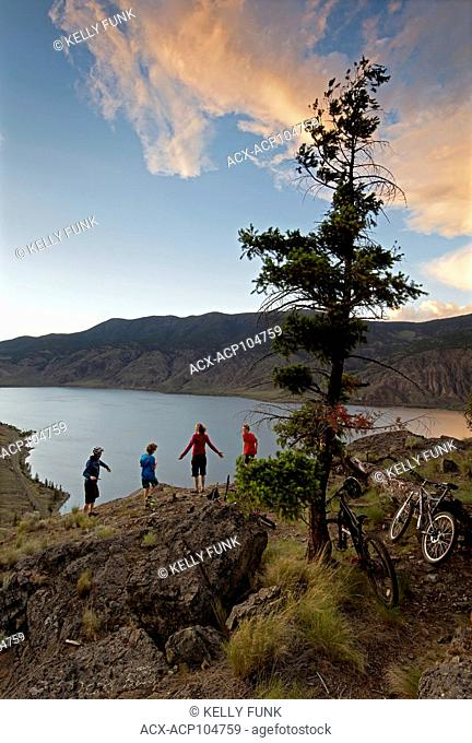 A group of mountain bikers finish their ride over Kamloops lake, west of Kamloops, Thompson Okanagan region, British Columbia, Canada