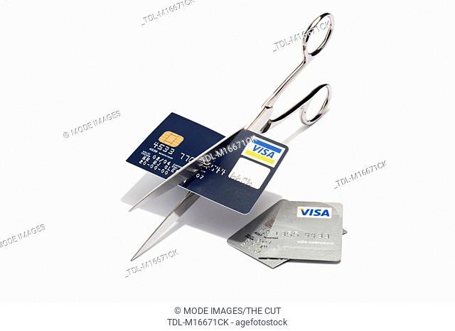 Scissors cutting up a visa credit card