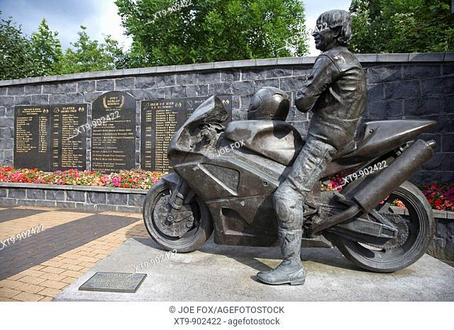 bronze sculpture of Joey Dunlop and his Honda motorbike in the Joey Dunlop memorial garden in Ballymoney county antrim northern ireland uk