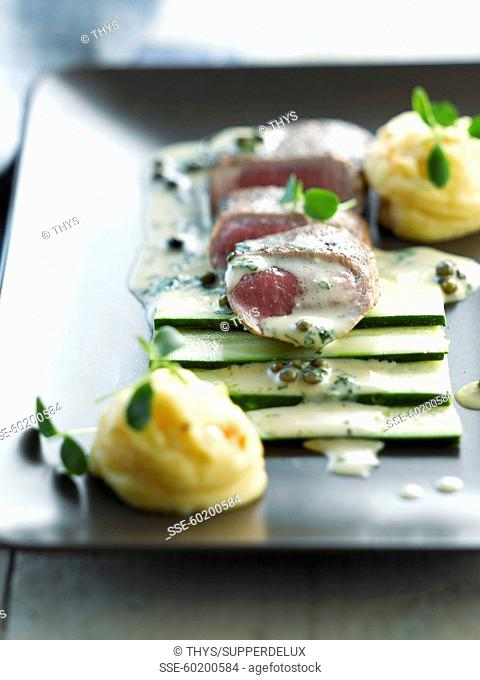 Lamb fillet with raw zucchinis and mashed potatoes with sesame seeds