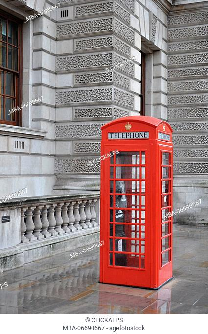 A typical english old call box with their red color, London, United kingdom