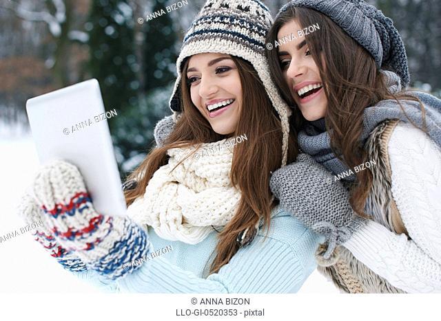 Sharing their online photo album in winter day. Debica, Poland