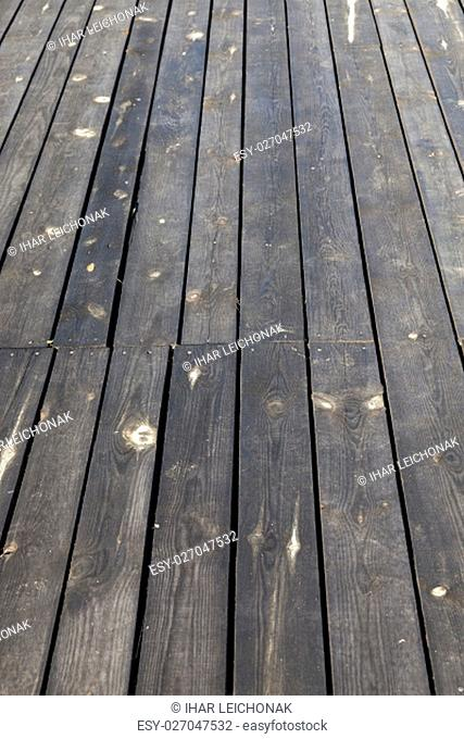 photographed close-up part of the wall made of planks, visible metal nails for attaching construction materials