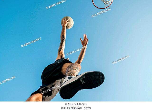 Low angle view of basketball player with basketball