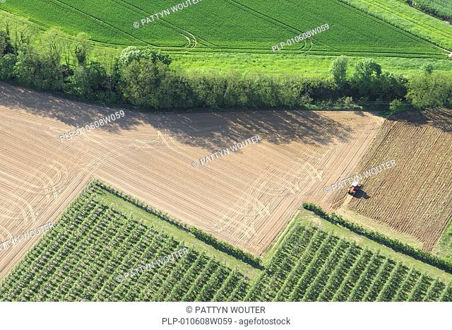 Tractor on field from the air, Belgium