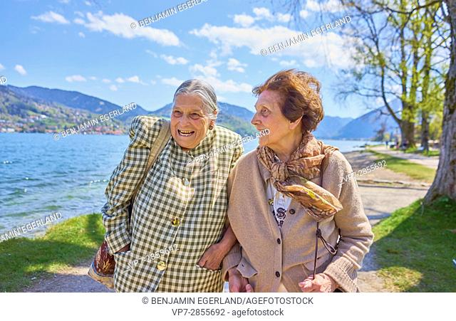 Happy two senior woman together at lake Tegernsee, Bavaria, Germany
