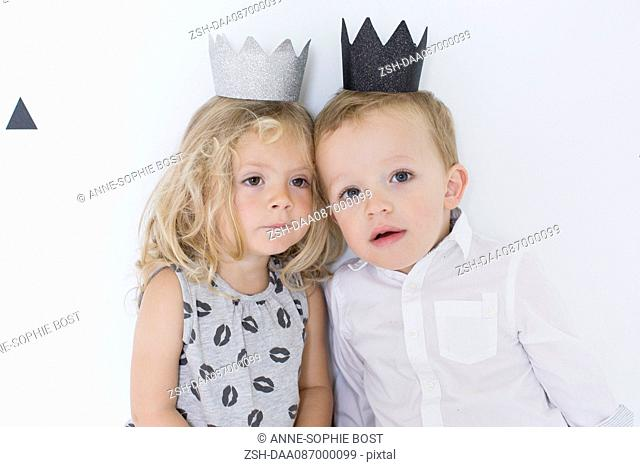 Children wearing paper crowns