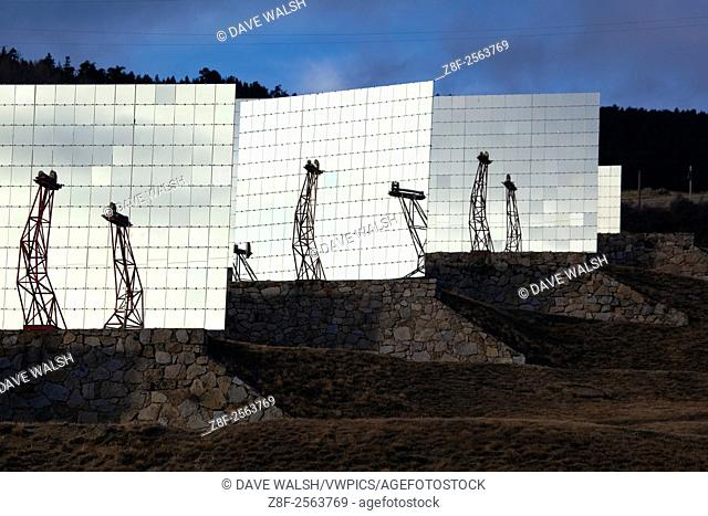 The Four Solaire d'Odeillo giant solar furnace, at the PROMES laboratory at the CNRS facility at Odeillo, France. By focussing intense sunlight through a system...