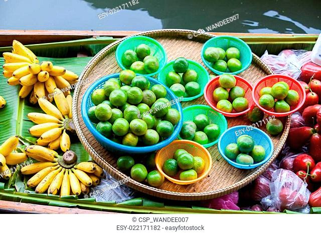 Traditional floating market for sell food and fruit, Thailand