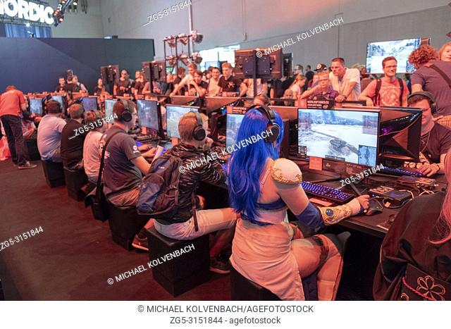 a0cde3fb1a6c Visitor in cosplay costume sitting in front of a military computer game at  the world s largest