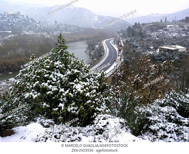 Snowfall at Montserrat Natural Park. Monistrol de Montserrat village countryside. Llobregat River and C-55 road. Barcelona province, Catalonia, Spain