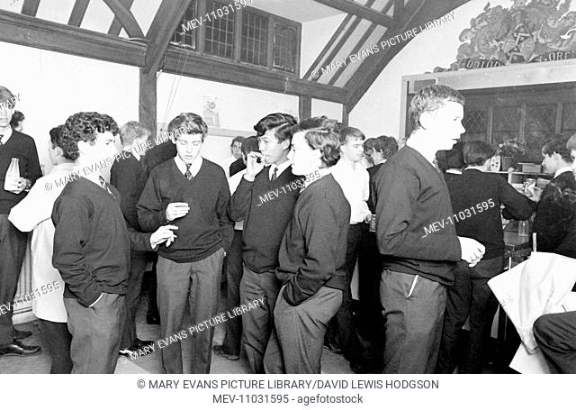Schoolboys stand around chatting in the refectory at Atlantic College (United World College of the Atlantic), St Donat's Castle, Llantwit Major, Glamorgan