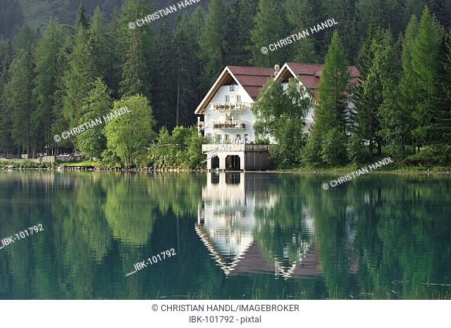 A hotel mirrors in the Antholzer Lake, South Tyrol, Italy