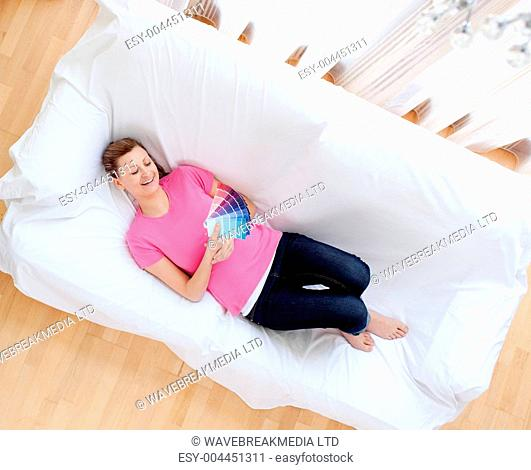 Radiant woman choosing colors to decorate her house