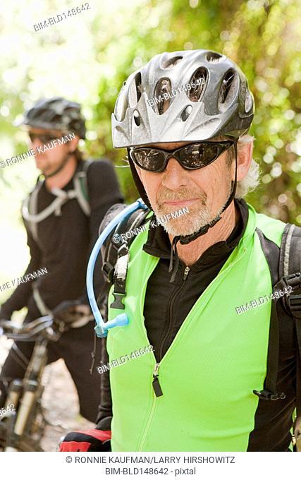 Caucasian man wearing sunglasses and bike helmet