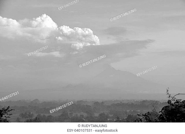 B&W. Morning Fog and Active Volcano Mount Merapi in Java, Indonesia
