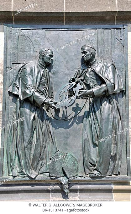 Pope John Paul II passes the World Youth Day Cross to his successor Pope Benedict XVI., bronze relief by the Duesseldorf artist Bert Gerresheim at the Koelner...