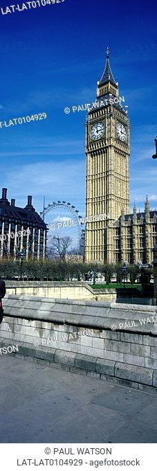 Houses of Parliament. Westminster. Big Ben clock tower. London Eye millennium ferris wheel behind. panoramic