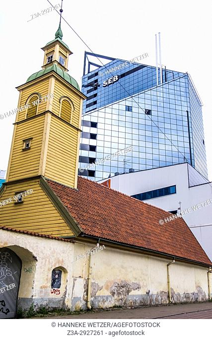 Church in front of a high rise building in Tallinn, Estonia, Europe