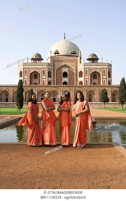 Young Indian women in front of Humayun's Tomb, Delhi, India