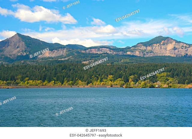 Summer view on the scenic West Columbia River in northern Oregon, with hilly landscape of Washington State in the background