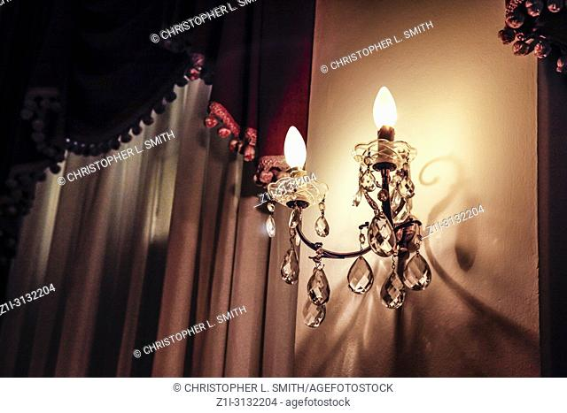 Crystal Chandelier wall lights lit up at the Hotel Imperial in Opatija, Croatia