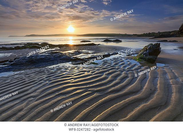 Sunrise captured from the western side of Harlyn Bay Beach, , near Padstow on the North coast of Cornwall
