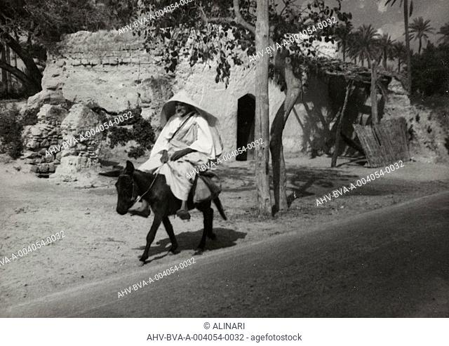 Album Aegean Cruise - Zara, Athens, Rhodes and Tripoli, May 1934: Elder riding a donkey on a street in Tripoli, shot 05/1934 by Balocchi Vincenzo