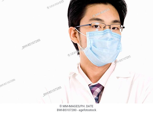 a young Asian doctor with blue face mask and white coat