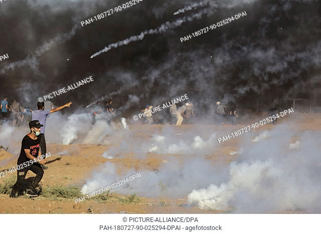 Tear gas canisters are fired by Israeli Security forces at Palestinian protesters during clashes along the Israel-Gaza border, east of Gaza city, Gaza Strip