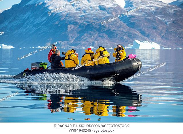 Tourist on Zodiacs exploring and photographing Icebergs, Scoresbysund, Greenland