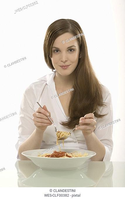 Woman eating noodles, portrait