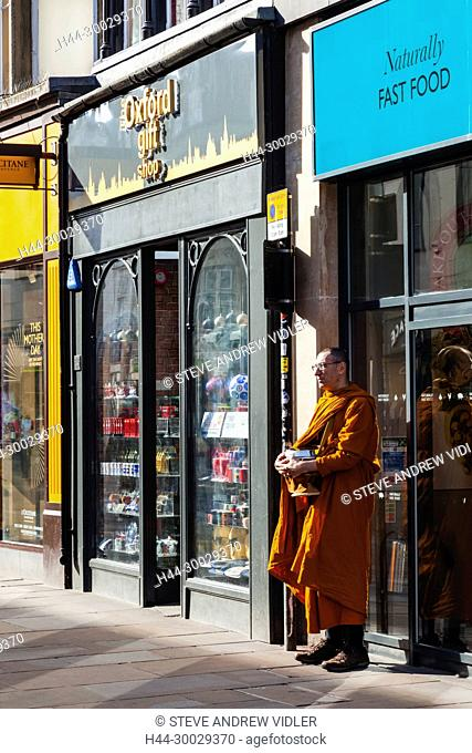 England, Oxfordshire, Oxford, Buddhist Monk Collecting Alms