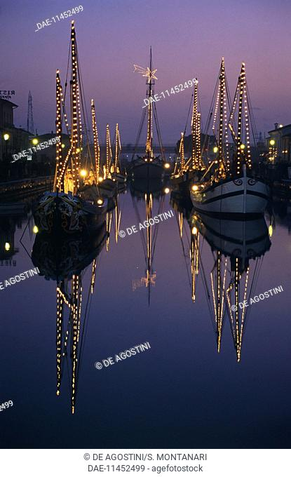 Boats lit up for the night crib, Maritime Museum, Porto Canale, Cesenatico, Emilia-Romagna, Italy
