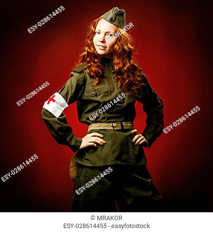 Historical reenactment of soviet union army by pretty girl in beautiful light on red background
